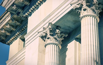 close up image of pillars outside a court house
