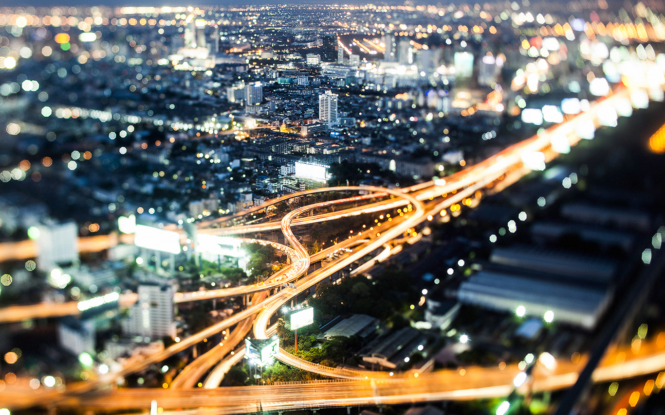 An aerial view of a busy city road network at night
