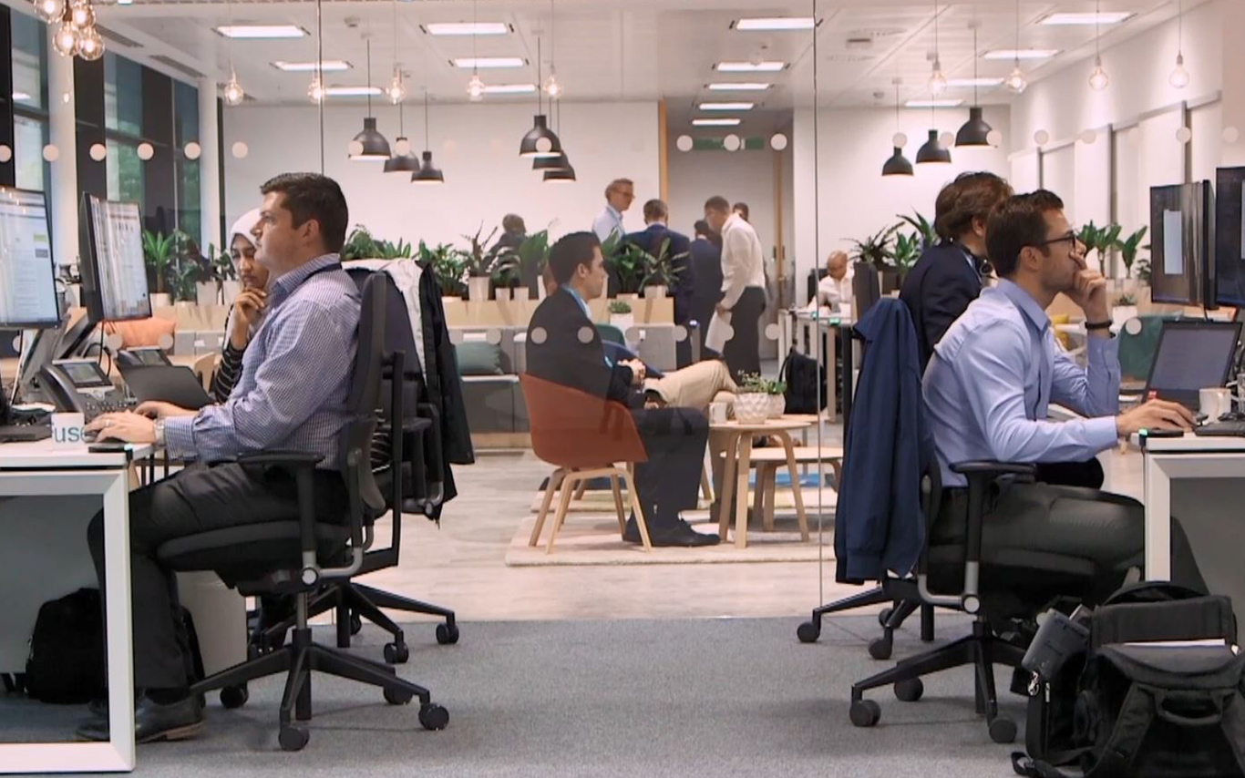 Office, colleagues sitting at desks working