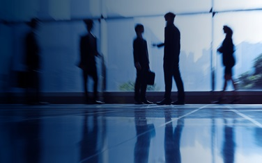 Silhouettes of people meeting