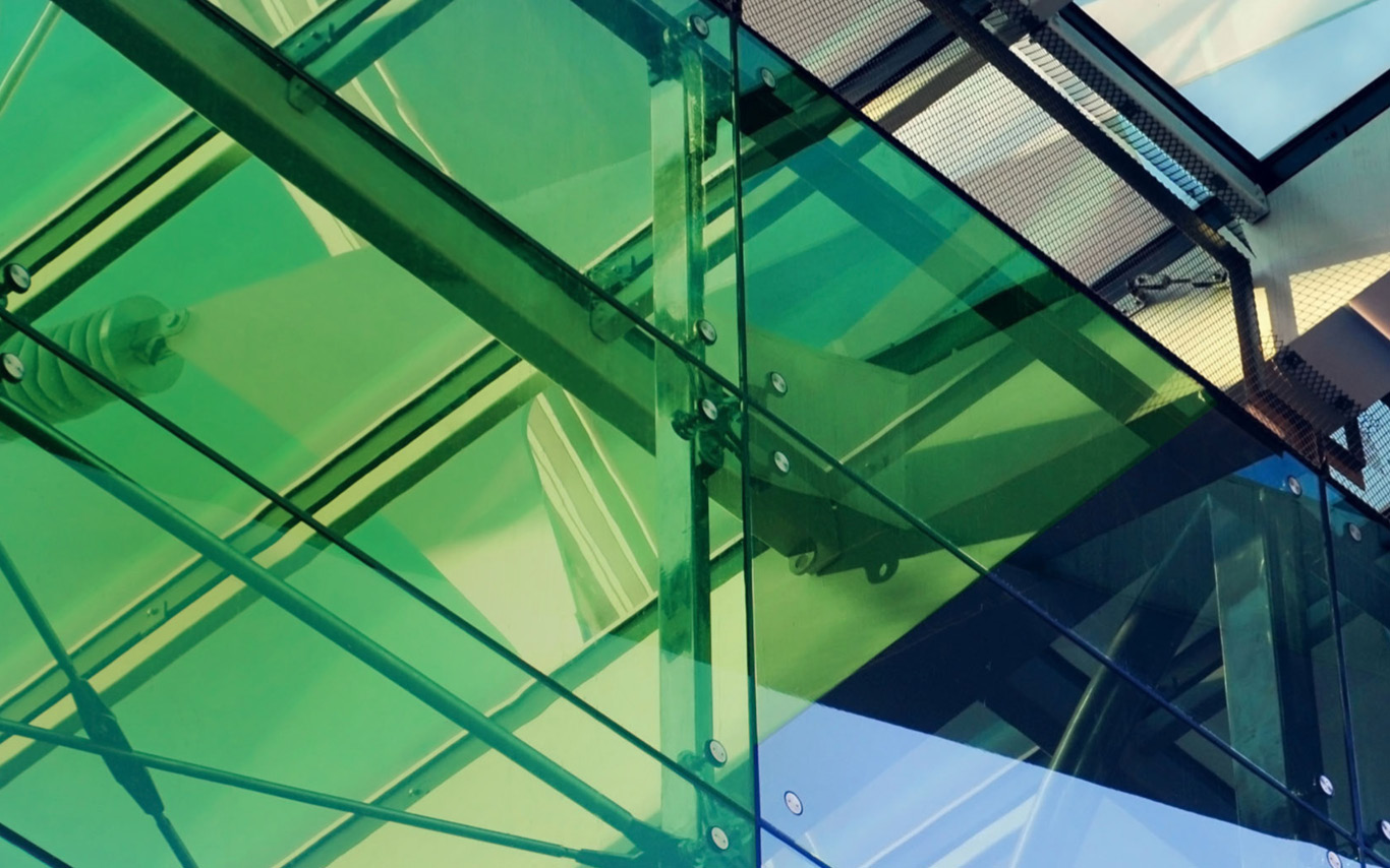 Close up of a modern green glass and metal building