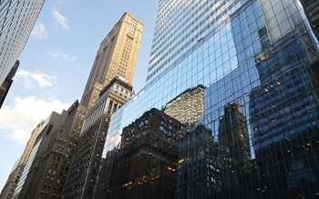 Glass building, city, reflections