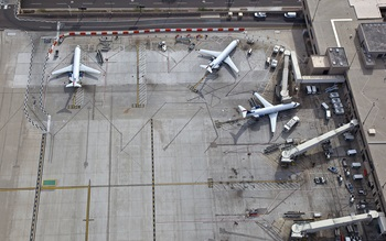 Parked aeroplanes at  an airport terminal