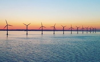 offshore wind farms with sunset