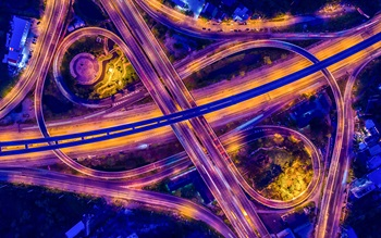 Bird's eye view of a busy illuminated road junction