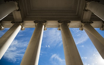 Ornate architectural columns against a blue sky