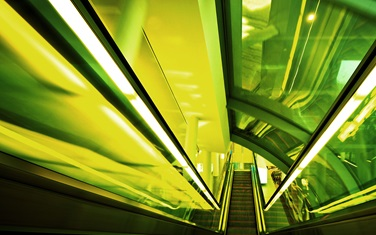 neon green downward escalator image